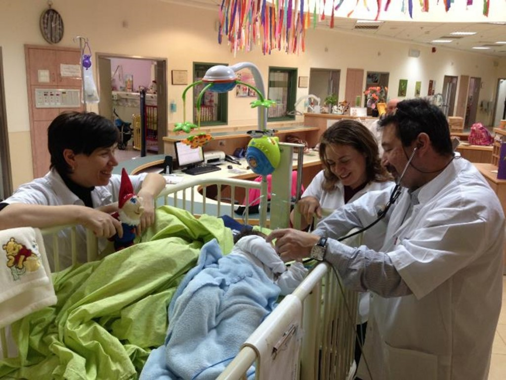 Nurses tend to a young child at ALEH Negev.