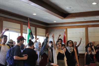 Students reportedly affiliated with GUPS disrupting Jerusalem Mayor Nir Barkat at San Francisco State University.