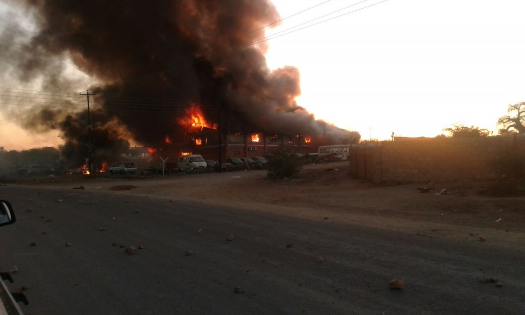 A warehouse belonging to the Zimbabwe Revenue Authority at Beitbridge set alight by protesters, who also put stones on the road.