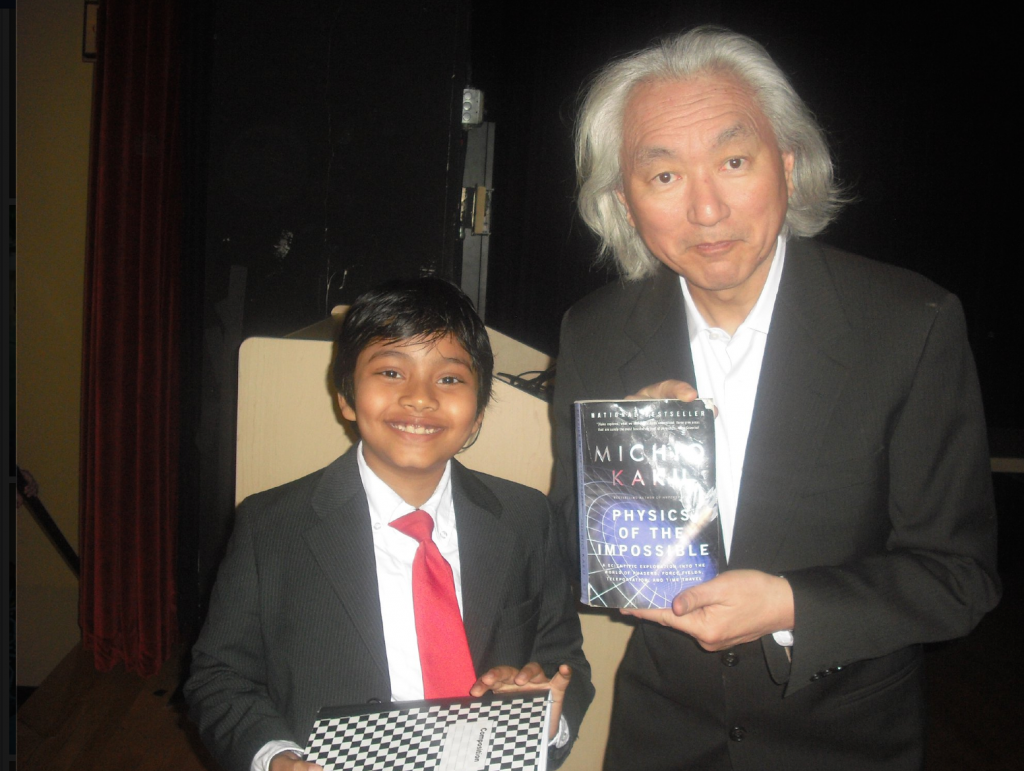 """Make Islam Great Again Campaign: Albert, also known as the """"13 year-old SAT expert"""" started sitting in college classrooms at the age of 5. Even Michio Kaku, the most famous scientist of our time, gave him permission to sit in his physics class. In this picture, Albert is collaborating with Kaku at the end of the class."""