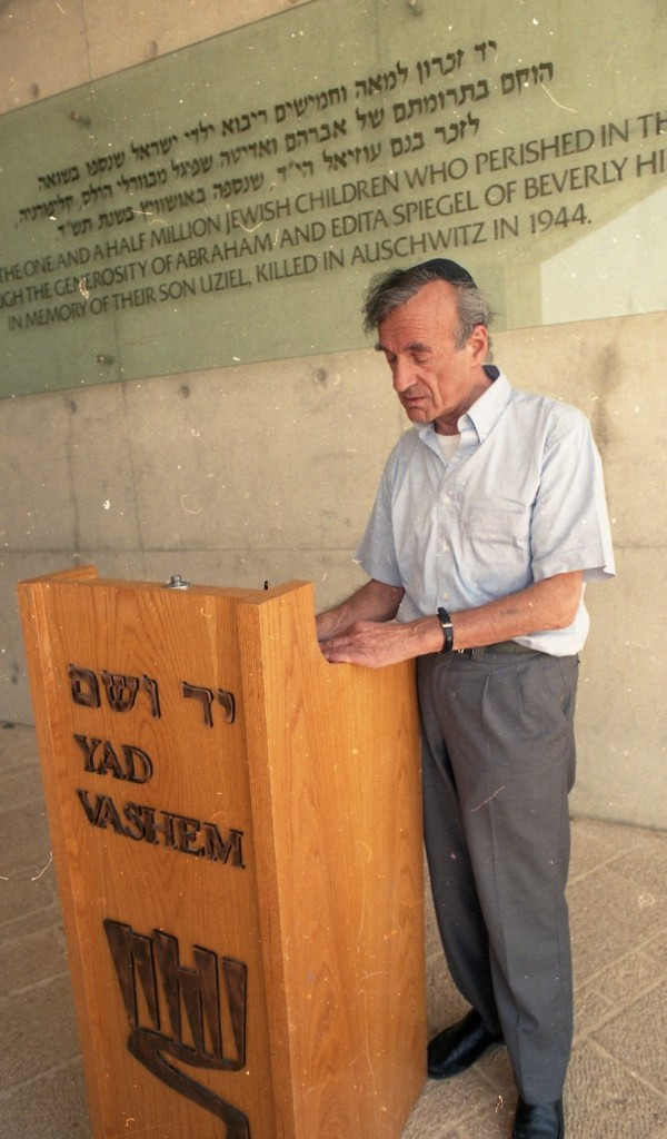 Prof. Elie Wiesel signs the Yad Vashem Guest Book outside the Children's Memorial (Courtesy of Yad Vashem)
