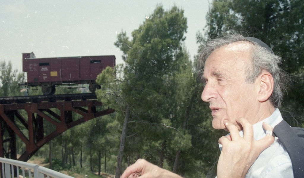 Prof. Elie Wiesel next to the Memorial to the Deportations at Yad Vashem (Courtesy of Yad Vashem)
