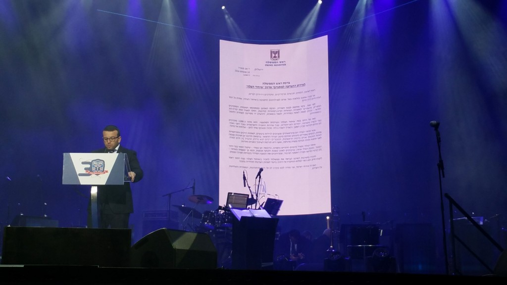 Prime Minister's letter screened and read to the crowd.
