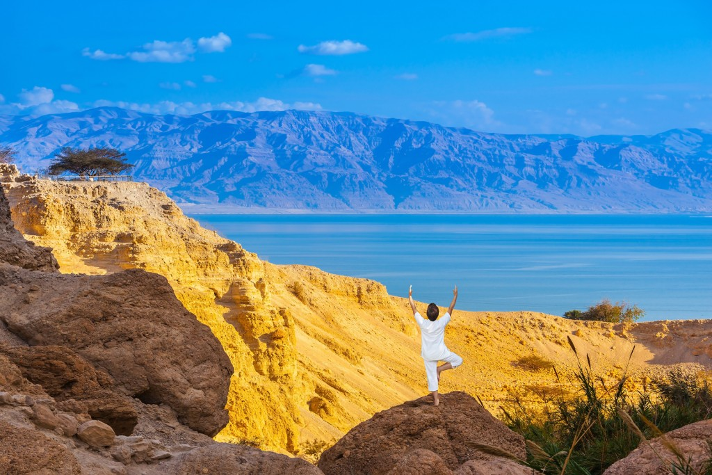 Woman Doing Yoga on a rock near the Dead Sea