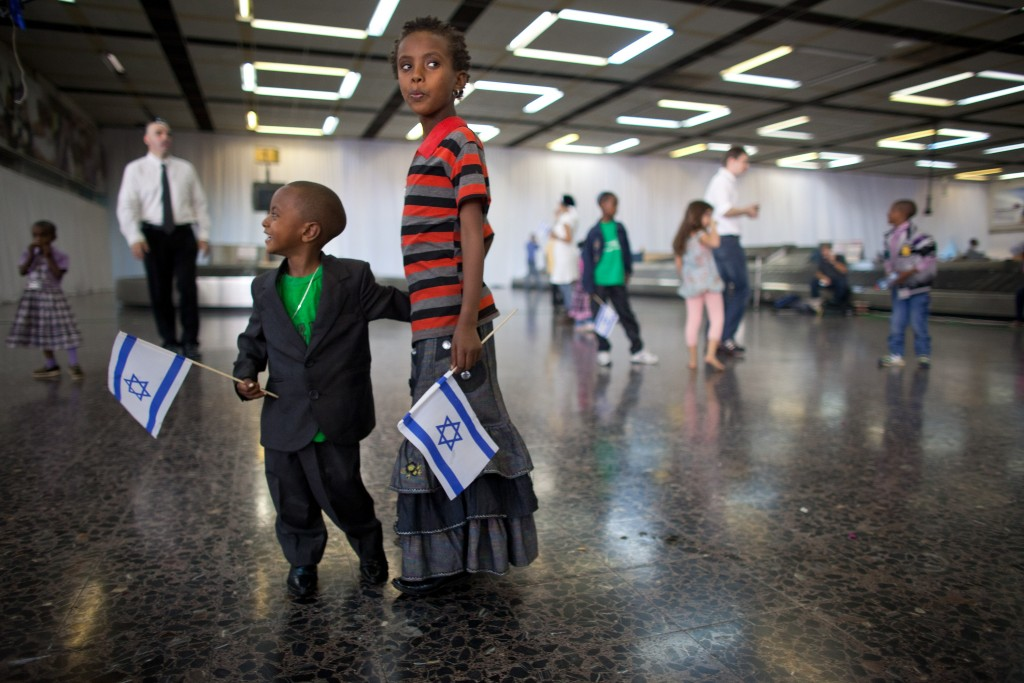 New Jewish immigrant children at Israel's Ben Gurion Airport after arriving on a flight from Ethiopia, Oct. 29, 2012. (Uriel Sinai/Getty Images)