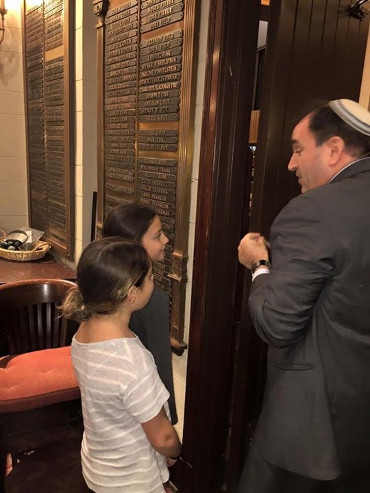 Rabbi Savenor places mezzuzah in area that is accessible to all