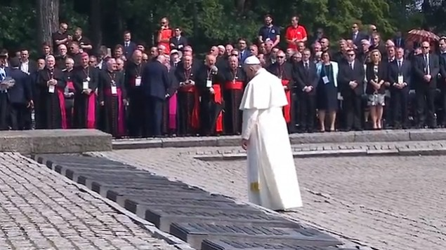 Pope Francis stands in silent prayer during a visit to the former Nazi death camp of Auschwitz in Poland (screen capture: YouTube)