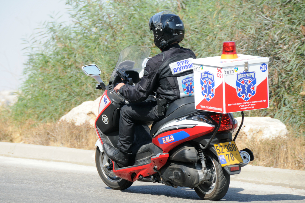 (Photo: An EMT on an ambucycle riding to an emergency. Credit: United Hatzalah)