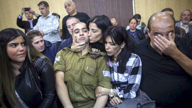 Elior Azaria arrives to the court room before announcement of his verdict, January 4, 2017 (Miriam Alster/Flash90)