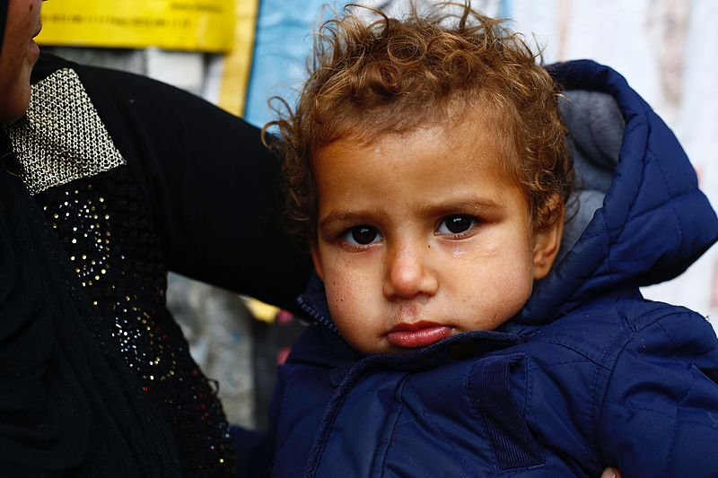 A Syrian refugee child (photo credit: Ahill34, CC BY-SA via Wikimedia Commons)