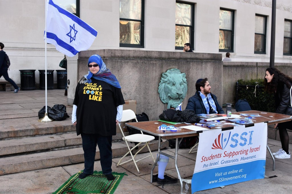Muslim Zionist activist Nadiya Al-Noor pauses for her daily prayers. Photo by @idost_nyc
