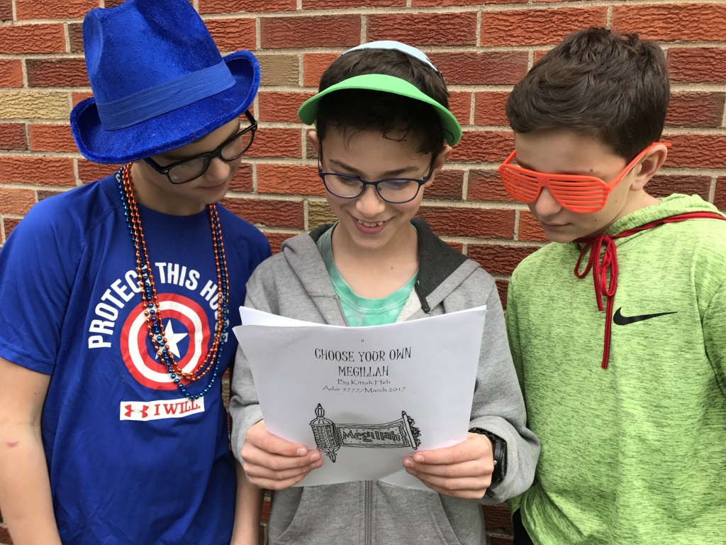 "Levi Rosenberg, Yuval Gottstein and Ilan Seinfeld-Chopp, fifth-graders at Hebrew Day School of Ann Arbor, read their class compilation of ""Choose Your Own Megillah""."