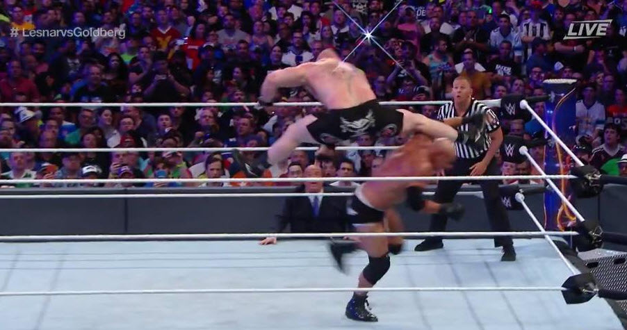 Lesnar averting a spear from the charging Goldberg (Photo Credit:WWE.com)