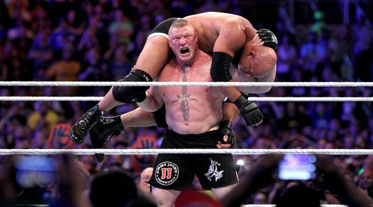 Lesnar getting ready to finish Goldberg off with an F5 (Photo Credit:WWE.com)