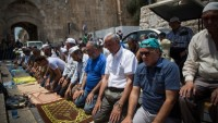 Muslims praying outside the Temple Mount (photo by Flash 90)