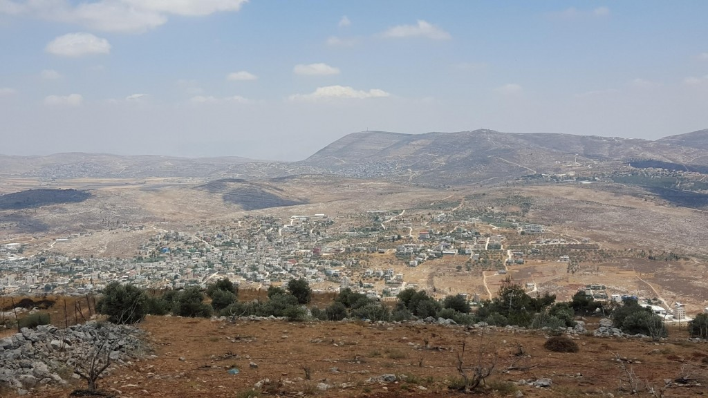 The view from the Har Bracha Winery visitor center overlooks the Shomron Mountains and the Palestinian city of Nablus (courtesy)