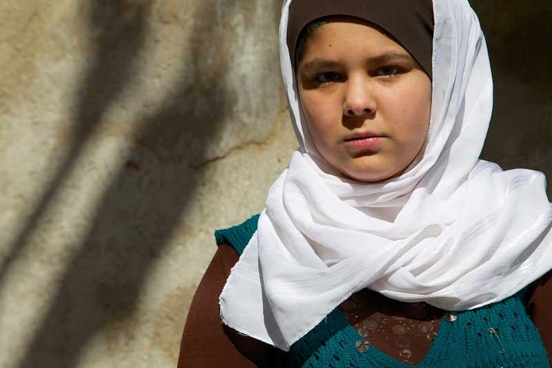 """In January 2013, an International Rescue Committee survey revealed that Syrian refugees cited rape as a primary reason their families fled the conflict. """"I chose to leave Syria because I heard that they'd attack and rape the girls, so I got worried about my daughters."""" Mervat says. Haneen, Mervat's eldest daughter says """"We can't go back to Syria until the war is over"""". Photo Credit: European Commission DG ECHO"""