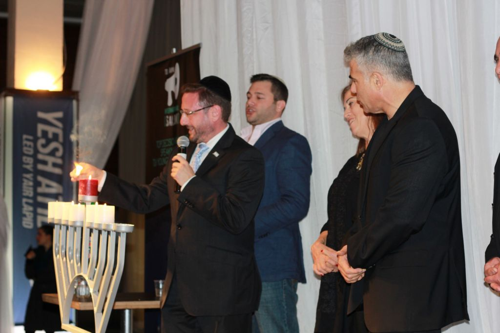 Lighting Chanukah candles alongside Yair