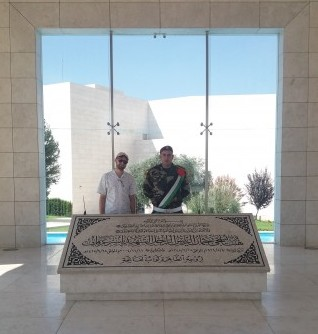 Izzy Posen at the Yassir Arafat Museum in Ramallah with a Palestinian guard