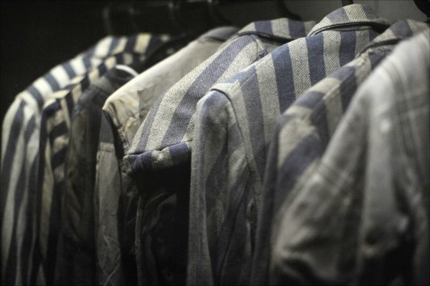 Striped uniforms of concentration-camp victims hang on display at the Ghetto Fighters Museum north of Akko, Israel. Photo: Larry Luxner
