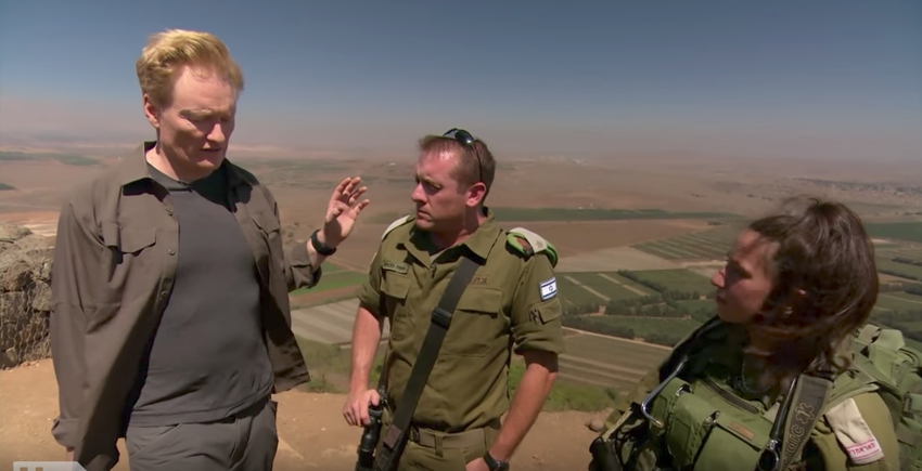 Conan O'Brien speaking with Israeli soldiers overlooking the Golan Heights, August 2017. (Screenshot from YouTube)