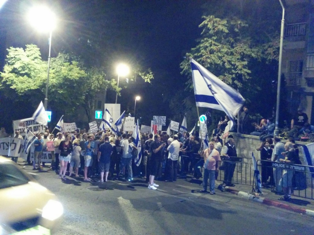Activists protest Supreme Court decision outside the home of Justice Naor in Jerusalem