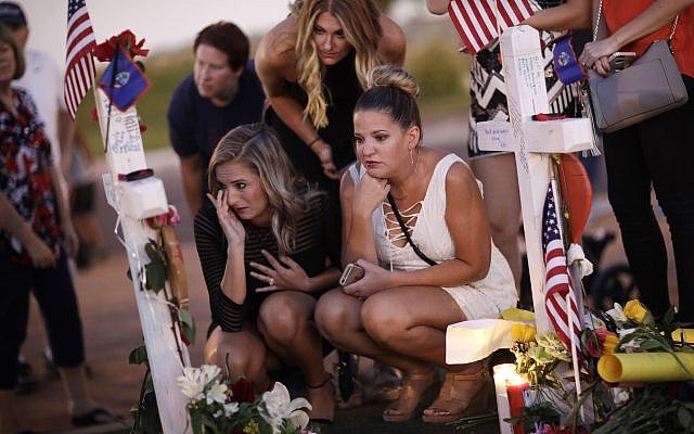 People visit a makeshift memorial for victims of a mass shooting in Las Vegas, October 6, 2017. (AP/John Locher)