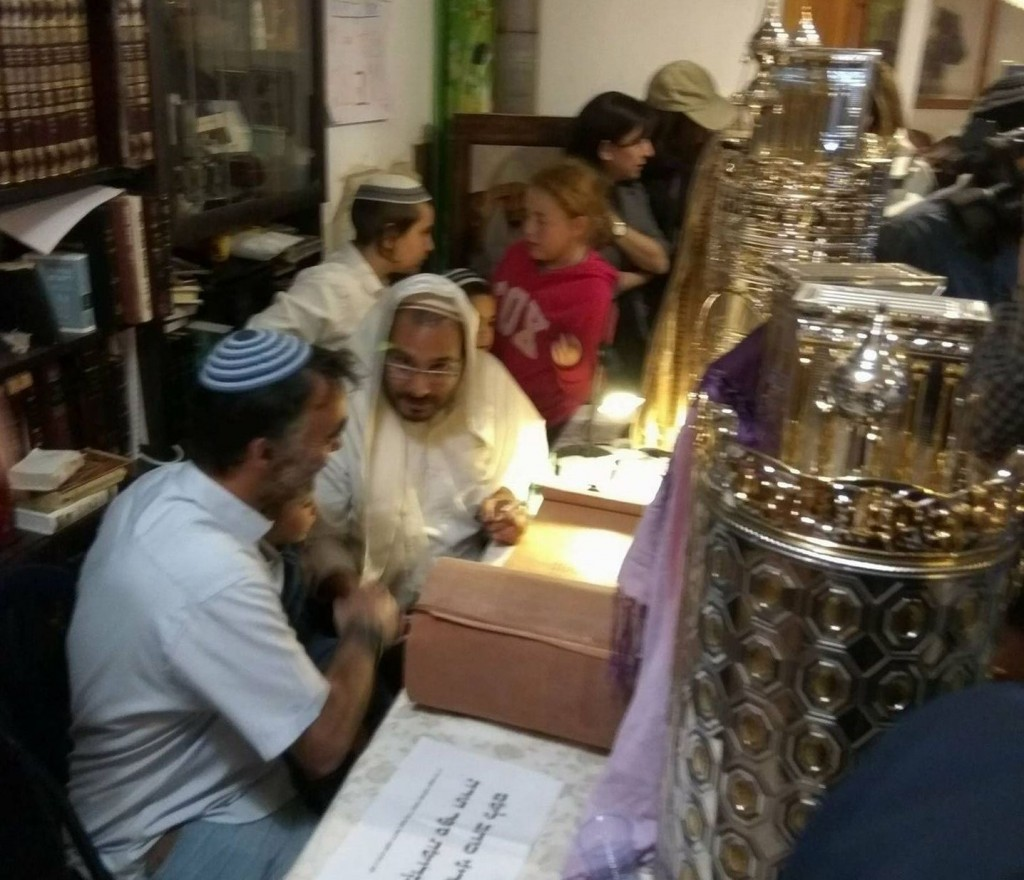 Completing a new Torah scroll in memory of Rabbi Raziel Shevach at Havat Gilad. (photograph courtesy of David Ha'ivri)
