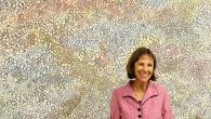 "Artist Harriet Finck in front of ""For Every Season"" (acrylic and ink on paper). Godwell Chan."