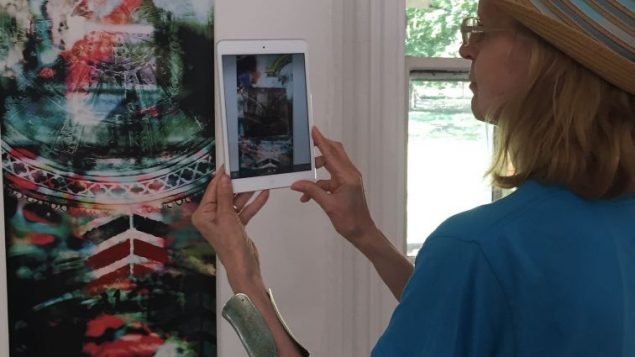 "Artist Yona Verwer viewing a ""hidden video"""