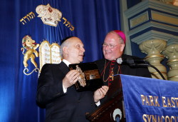 Archbishop Timothy Dolan, right, with Park Avenue Synagogue Rabbi Arthur Schneier. The archbishop spoke at the shul last week.