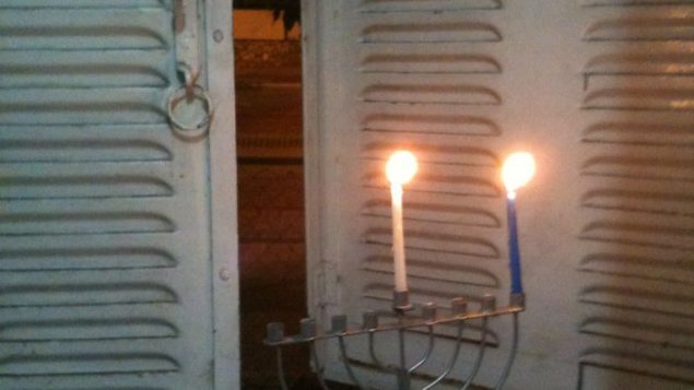A photo of my late-night candle lighting on the first night Chanukah