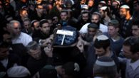 Mourners carry the remains of 3-month-old Hadas Fogel, youngest victim of the March 11 Itamar massacre. Getty Images