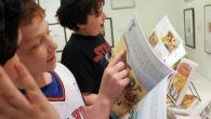 Students browse Passover books at Park Avenue Synagogue
