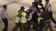 During an Independence Day celebration, Yoel Shalit, was escorted away by security after disrupting the event. jta