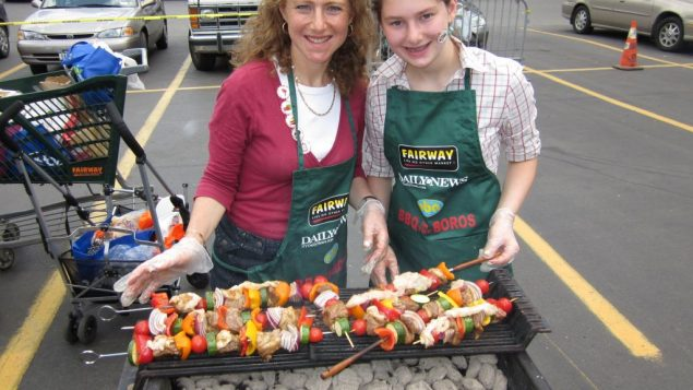 "Tery Blatt, left, got a helping hand with her steak kabobs from daughter Gabriella at the ""BBQ in the Boroughs"" competition."