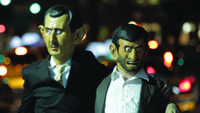"In street theater performance, actors portraying Syria's Bashir Assad, left, and Iran's Mahmoud Ahmadinejad, ""married"" this week"