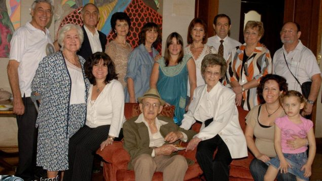 Sylvia Jossel surounded by descendants of Ochberg