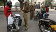 Indian police checking IDs of motorcyclists outside the Israeli Embassy in New Delhi after the terror attack in February. (photo credit: AP/Saurabh Das)