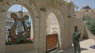 An Israeli soldier stands next to the entrance to the City of David archaeological park in this file photo. (photo credit: Matanya Tausig/Flash90)