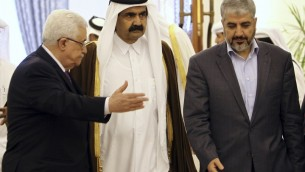 The Emir of Qatar Sheikh Hamad Bin Khalifa Al-Thani, center, Palestinian President Mahmoud Abbas, left, and Hamas leader Khaled Mashaal, right, arrive to sign an agreement in Doha, Qatar. A rare public rift broke open Sunday, Feb. 12, 2012 in the usually tightly disciplined Islamic movement Hamas over a reconciliation deal that would require it to relinquish key areas of control in the Gaza Strip. (photo credit: AP/Osama Faisal, File)