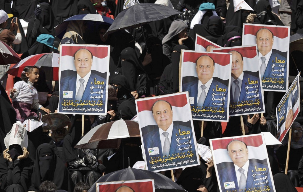 Yemeni women hold campaign posters that reads, 'Together we build a new Yemen, Abed Rabbo Mansour Hadi,' during a pro-election rally in Sanaa on Monday (photo credit: AP/Hani Mohammed)