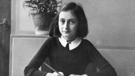Anne Frank, age twelve, at her school desk in Amsterdam, 1941