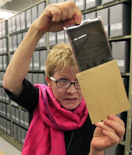 In this Thursday, Feb. 23, 2012, photo Bridget Sisk, chief of Archives and Records Management Section (ARMS) at the United Nations, views a 1947 negative file during a special tour of U.N. historical archives. (photo credit: AP Photo/Bebeto Matthews)
