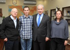 Gilad Shalit and his parents with Prime Minister Benjamin Netanyahu in Tel Aviv on Thursday (photo credit: GPO)