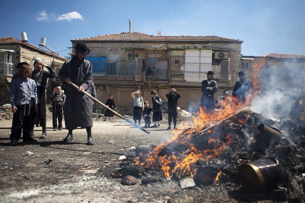 A waste and a safety hazard. Ultra-Orthodox Jews burn hametz before Passover in Jerusalem (photo credit: Matanya Tausig/Flash90)
