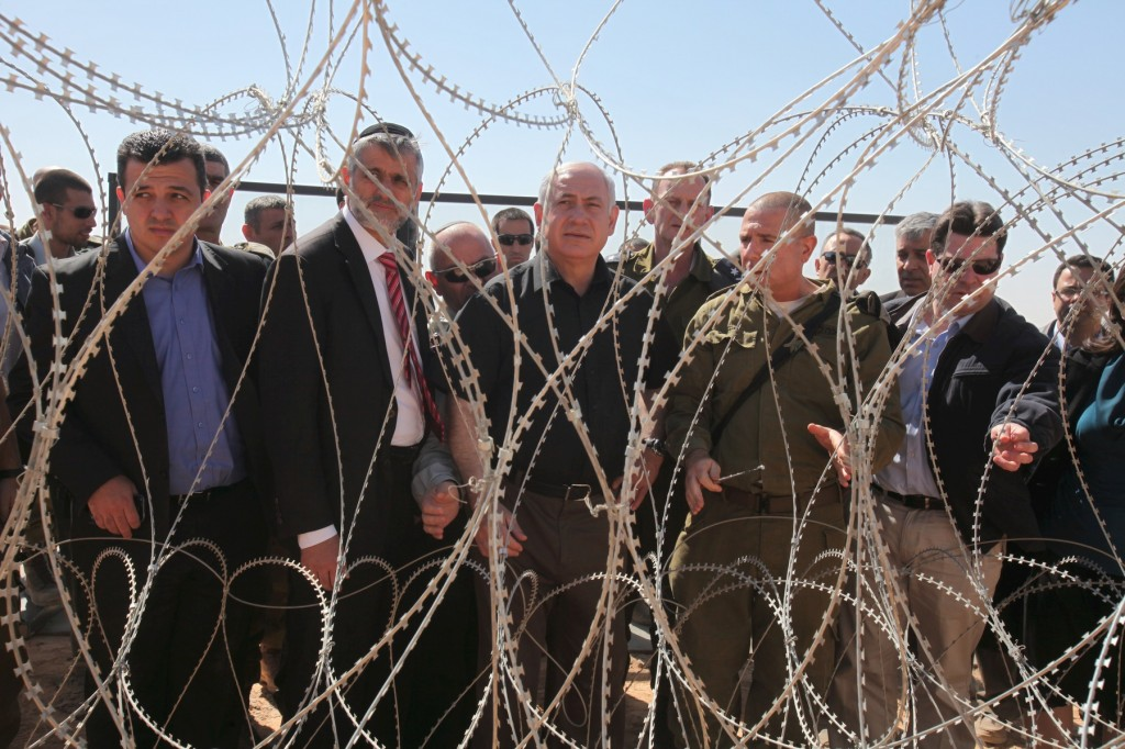 Prime Minister Benjamin Netanyahu and Interior Minister Eli Yishai during a visit to the Israeli-Egyptian border last year. (photo credit: Amit Shabi/Flash90)