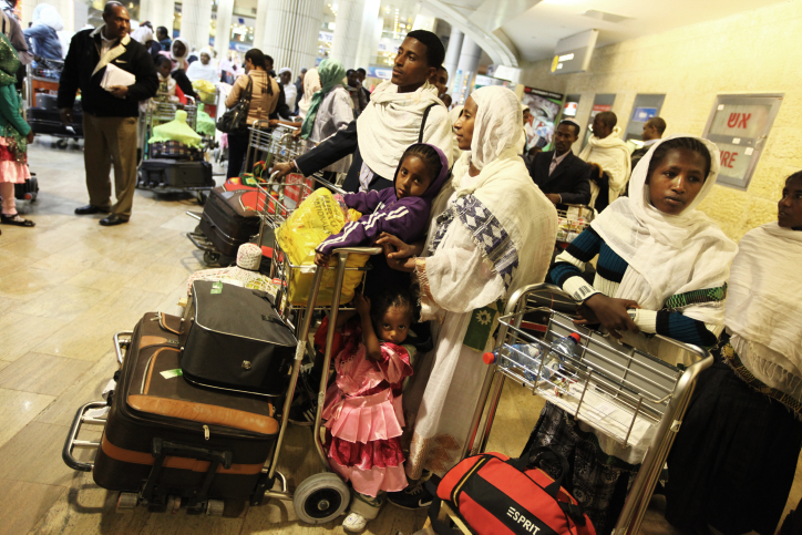 Newly arrived Ethiopian immigrants at Ben Gurion International Airport (photo credit: Kobi Gideon/Flash90)