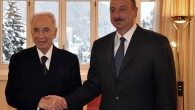 President Shimon Peres meets with Azerbaijan's President Ilham Aliyev at the World Economic Forum in Davos, Switzerland, in January. (photo credit: Flash90)