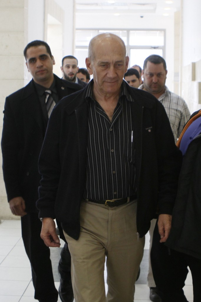 Olmert's other lasting legacy is being at the top of the leader board for the most investigated Israeli prime minister in history. Ehud Olmert at the Jerusalem District Court (photo credit: Uri Lenz/Flash90)